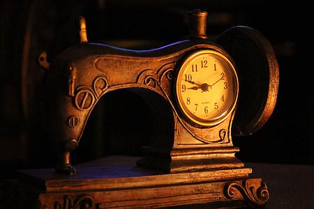 brown analog sewing machine themed clock