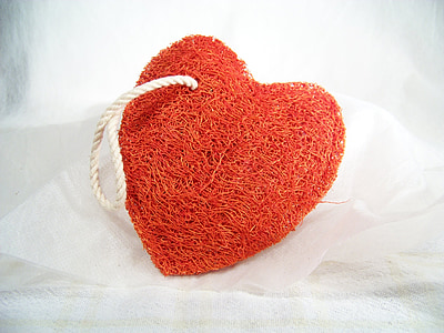 red heart body scrub on white textile