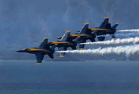 four blue aircrafts