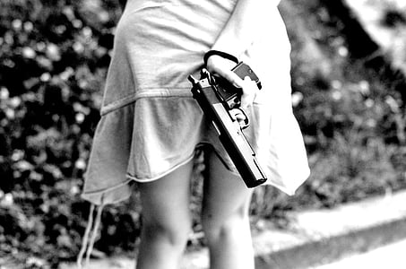 girl holding semi-automatic pistol