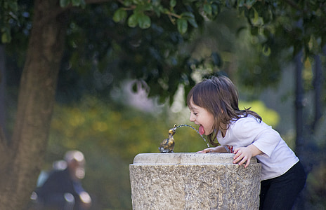 girl's drinking on water fountain