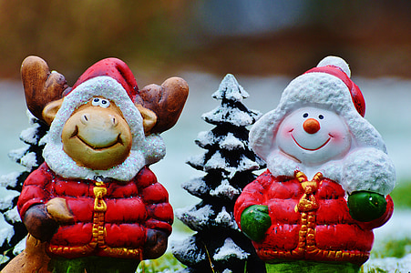 two snowman and reindeer with jacket figurines