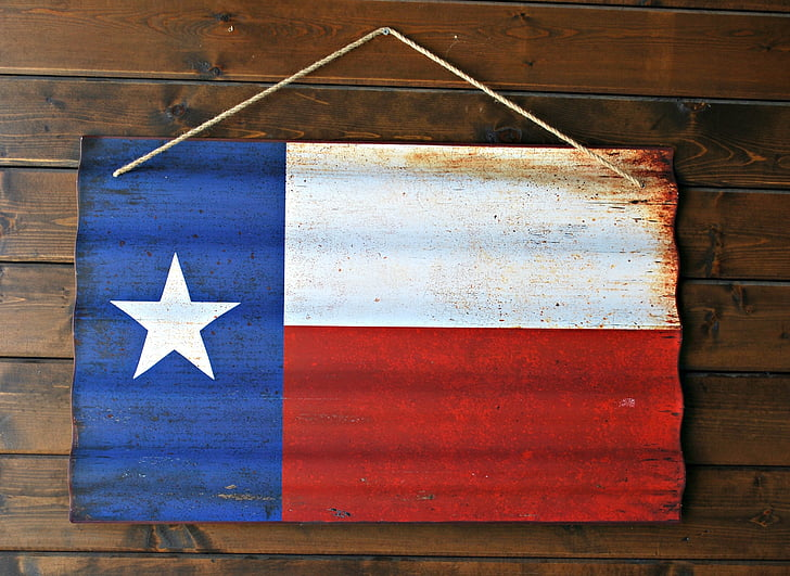 Royalty-Free photo: Flag of Chile wall decor hanged on brown wall ...