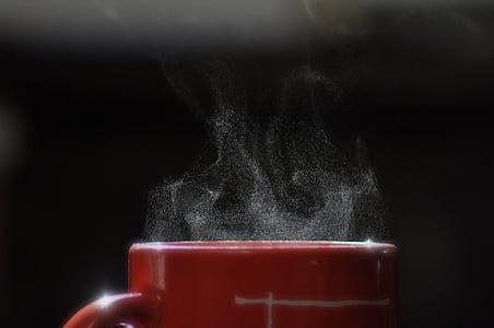 red ceramic mug with hot beverage
