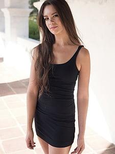 photo of woman wearing black sleeveless dress