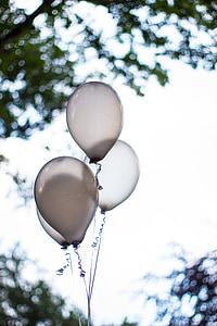 four white balloons on selective focus photo