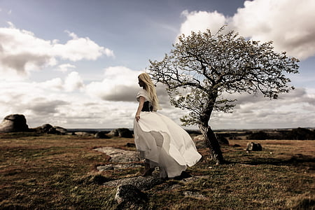 woman in white dress in the middle of the field