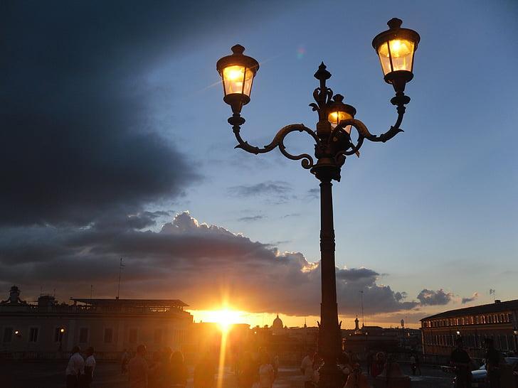 black 3-light street light