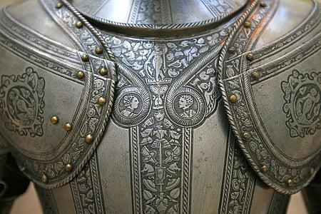 gray and brown metal armor photo