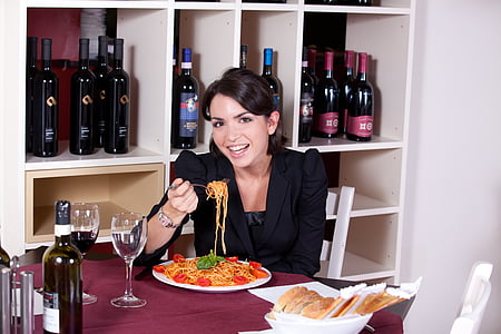 woman eating cooked pasta