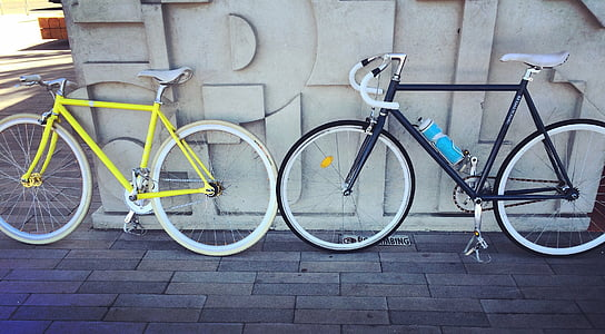 photo of two yellow and black single-speed bikes