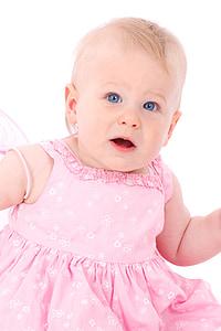 baby wearing pink dress