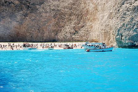 people near body of water