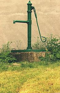 green deep water pump beside green plants