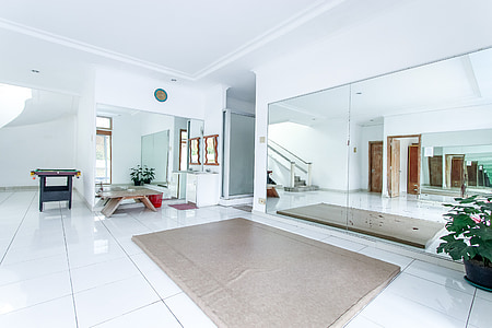 area rug in front of mirror