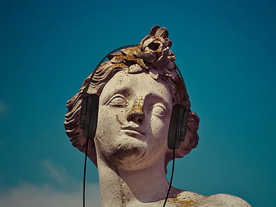 male statue with headphones