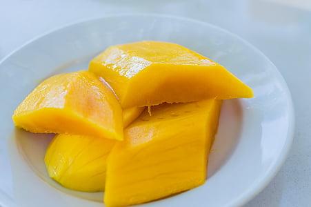 sliced mango fruit on white plate