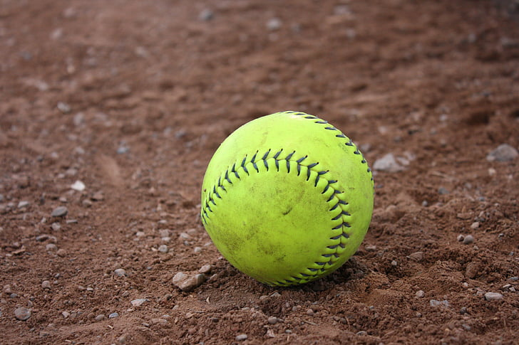 green baseball on brown soil