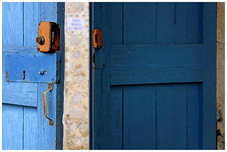 blue wooden door open
