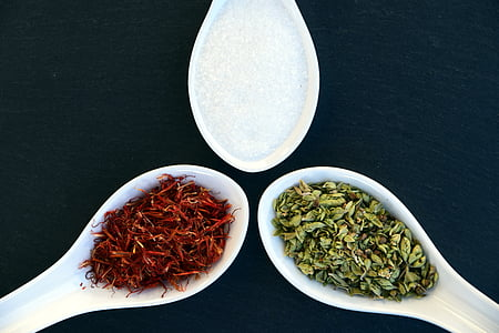 three spoons of variety of spices