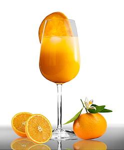 orange fruit beside clear long-stemmed wine glass