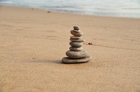stack of stones near seashore during daytime