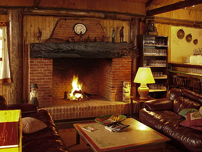 photo of brown and black fireplace