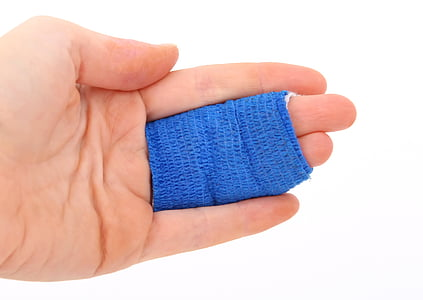 person with blue bandage on two fingers