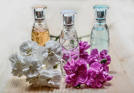 three assorted-scent fragrance bottles