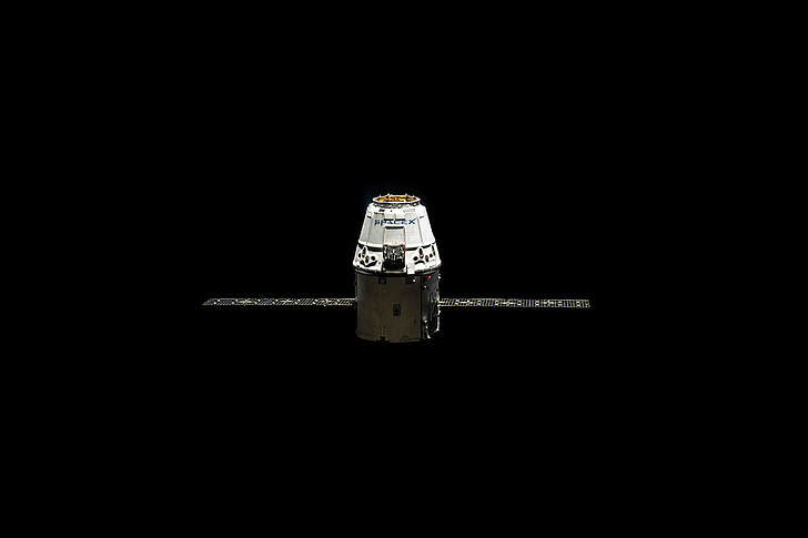 Royalty-Free photo: White and black satellite pod with two solar