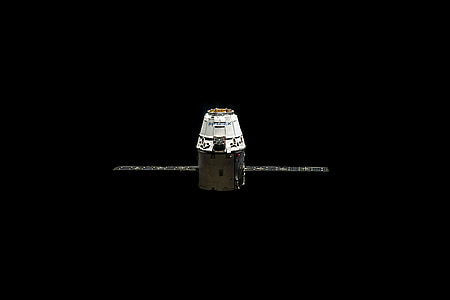white and black satellite pod with two solar arrays