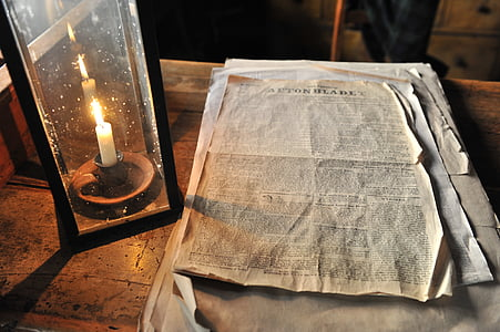 book page on table near candle
