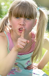 girl put her hand on lips