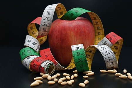red apple fruit with measuring tape