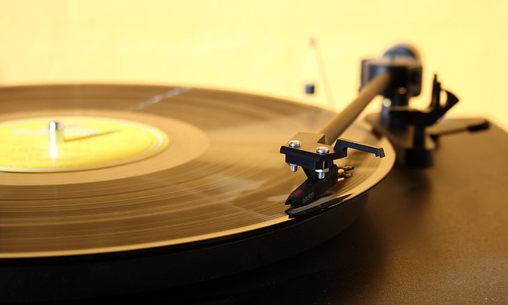 focus photography of black vinyl record player