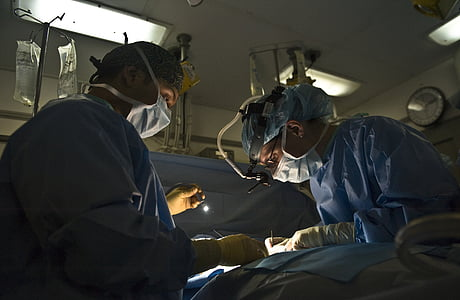 photo of doctors doing operation
