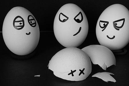 three eggs surrounding broken egg