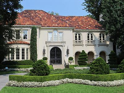 white house near green grass