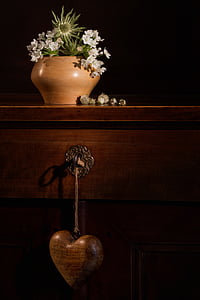 green leafed plant on brown vase on top brown wooden table
