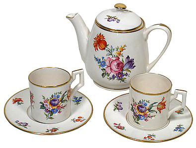 white-pink-and-blue floral ceramic teapot, teacups, and saucers