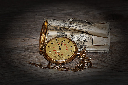 gold-colored pocket watch at 12:55