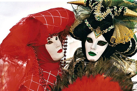 two person with masquerades
