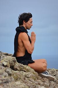 man meditation on boulder