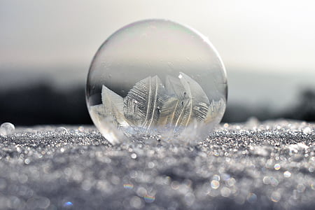 depth photography of clear glass ball
