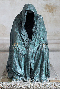 person wearing gray coat statue