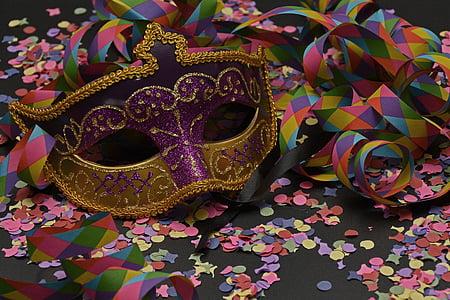 purple and yellow masquerade mask