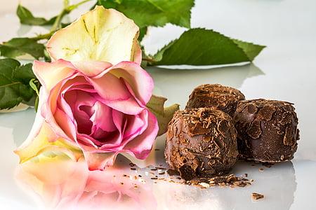 three chocolate bars beside flower