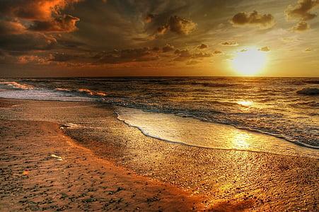 photo of beach sunset at sunset