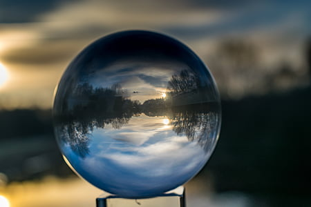 shallow focus photography of crystal ball reflecting lake