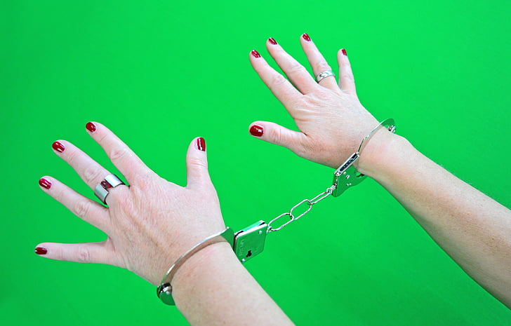person wearing gray metal handcuff